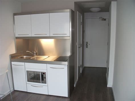 studio kitchen ideas student accommodation sink and kitchen island work surface storage facing the
