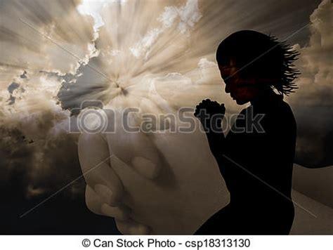 woman praying silhouette. woman kneel praying in