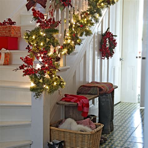 festive decoration company white painted hallway with garland ideal home