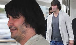 Keanu reeves is almost unrecognisable as he packs a paunch while