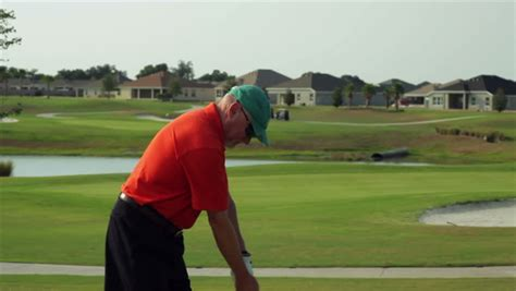 left thumb pain golf swing a golfer grabs his lower back and winces in pain during a