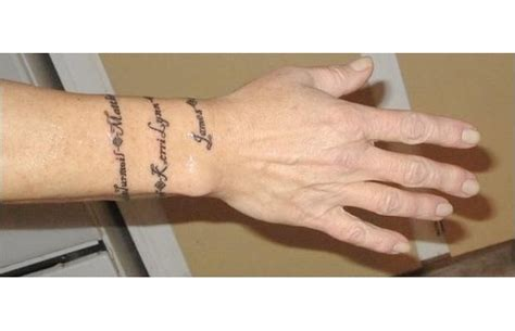 wrap around wrist tattoo best 25 wrist bracelet tattoos ideas on