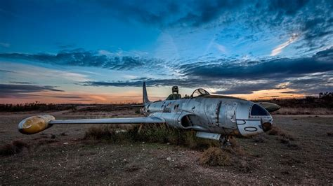 old plane at a military airfield wallpapers and images