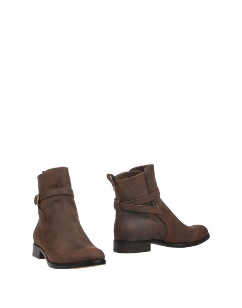 kors shoes lyst kors by michael kors ankle boots in brown