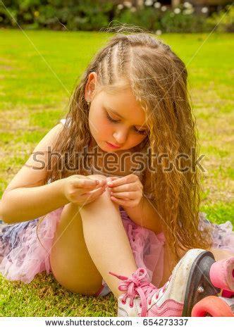 little girls legs little girl preschool sitting on ground stock photo
