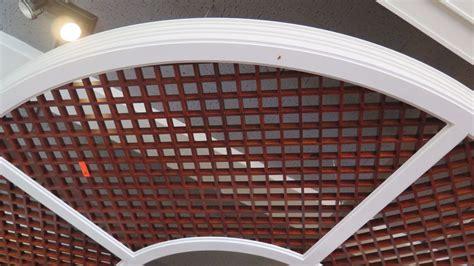 grid pattern wood wooden grid pattern ceiling panels w circular white trim