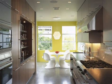 a galley style kitchen decorating ideas using paint colour on the far end to draw the eye in