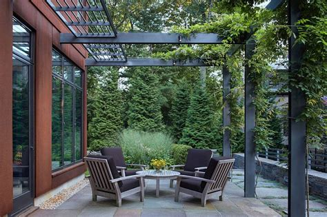 Modern extension to the existing Georgian home comes with a steel pergola structure Cap Hill