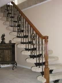 Ine image of home interior stair design using black wrought iron