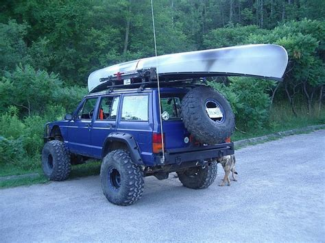 jeep cherokee kayak rack this one has it all cherokee tire carrier roof rack