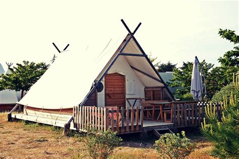 camping house built with wood and canvas home design