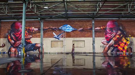 hyperlapse captures  graffiti artists covering