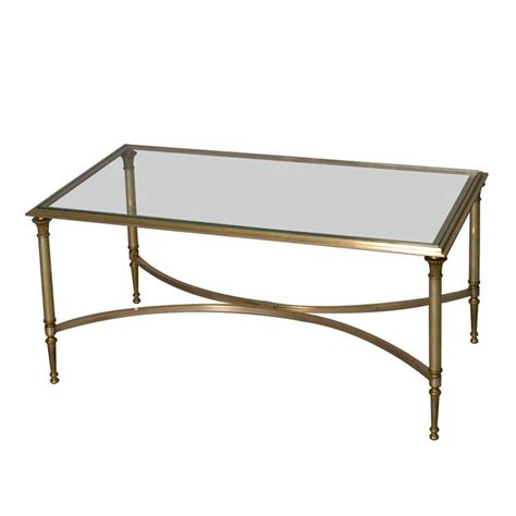 bronze frame glass top coffee table by maison charles at