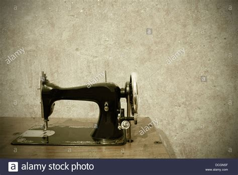 A Very Old Sewing Machine On A White Background Stock