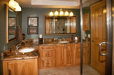 bath remodel with hickory cabinets and granite tops