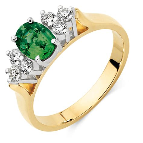 ring with green sapphire 0 26 carat tw of diamonds in