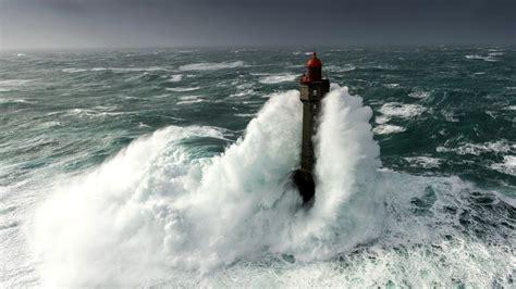 nature landscape clouds lighthouse storm waves sea