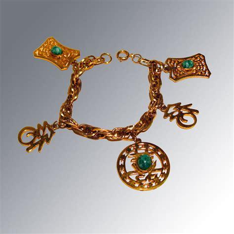 hattie carnegie asian charm bracelet vintage fashion