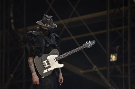 eliquis ad man with guitar person in black shirt with a black telecaster guitar