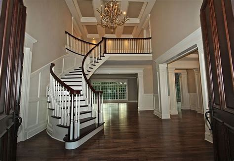 Open Foyer Ideas Open Foyer With Curved Staircase For The Home