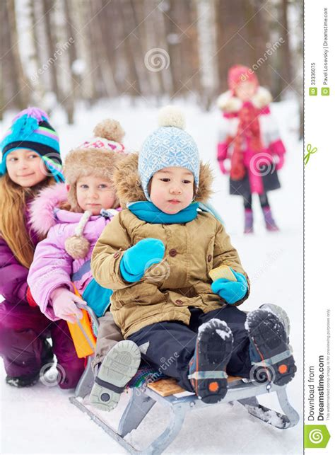 soap two girls and one boy pushes sled with two children stock image image of child laugh 33336075