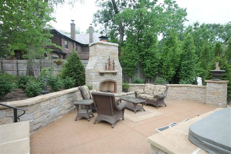 unique stone table with fireplace completing outdoor university city pool and outdoor kitchen renovation poynter