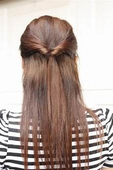 quick half up style for long straight hair tied by twisting in two bangs from front pictures