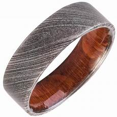 wedding ring with wood inside mens wedding band damascus steel ring leopard wood inside