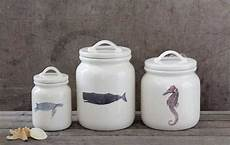 ceramic cannisters with sealife images and lids at seasideinspired com beach ocean home decor