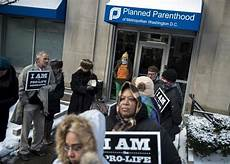 white abortion activists scream at black pro student abortion clinic protesters catholic moral theology