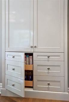 lovely kitchen features built in pantry cabinets stacked over cabinet doors disguised as drawers