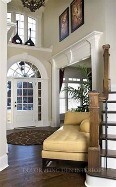 Home Entrance Wall Decor Ideas by High Ceiling Window Treatments This Foyer Lends A