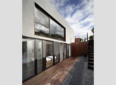 Sunken Courtyard House Partially Submerged to Fit Into Low