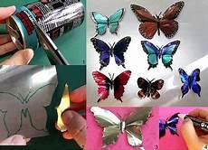 econotas com mariposas con latas recicladas