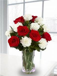 red rose and white carnation bouquet centerpiece picture