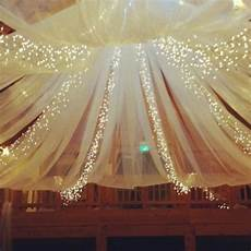 how to decorate a ceiling with tulle and lights instructions from the experts