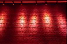 brick wall background with light bulb photo premium download