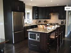 dark cabinets and dark flooring home and remodeling ideas dark kitchen cabinets kitchen