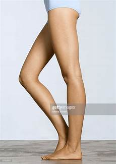 Womans Legs With One Knee Bent Stock Photo Getty