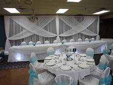 blue and white wedding decor backdrop head table and cake table with spot lights mirror