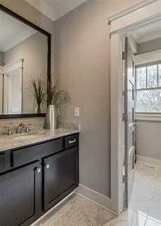 transitional bathroom with sherwin williams colonnade gray sw 7641 warm gray wall paint color in