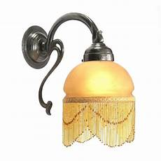 traditional victorian replica wall light with beaded glass shade