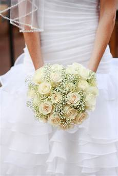 diy classic ivory rose and baby s breath bouquet