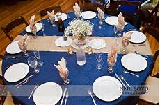 navy blue and brown wedding wedding reception table with baby s breath floral centerpiece