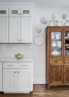 love my oak cabinet against the white wall paint color walls and cabinets white dove