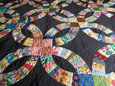 1000 images about double wedding ring quilts pinterest black backgrounds quilt and