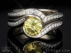 curved diamond channel wedding bands by krikawa