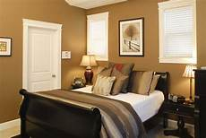 tag for bed color ideas a warm and cozy bedroom with dark hardwood floors and choosing the image result for bedroom ideas warm colors bedroom paint