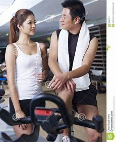 fitness male and female man and woman talking in gym stock image image 35621277