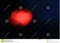 heart shaped black background colorful lighting bokeh for decoration at backdrop